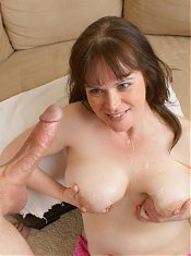 Ginger is the curvy and very busty mature chick giving a younger guy a head on webcam